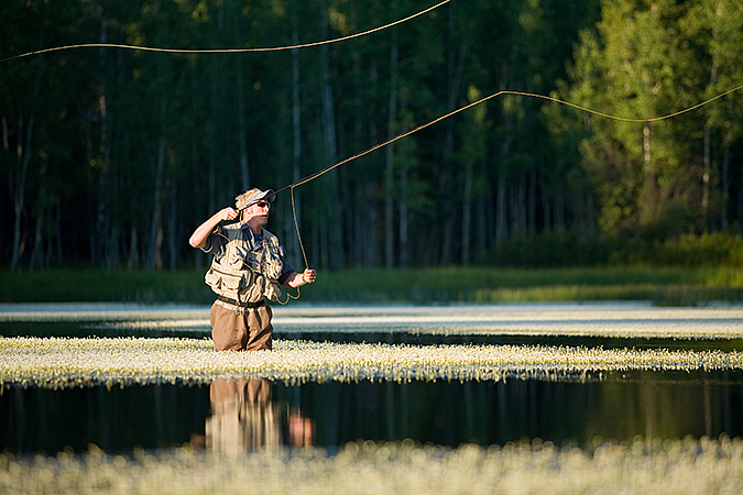Kevin Riehle flyfishing at Aspen Mirror Pond, Cedar Mountain, Utah